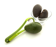 Avocados in glass bowl with slicer Stock Photography