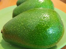 avocados-on-green-plate Stock Photo