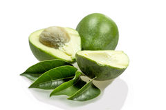 Avocados and leaves. Isolated on white Royalty Free Stock Image