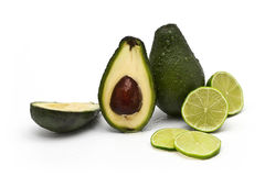 Avocados and limes Stock Photo