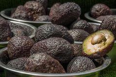 Avocados. One of them is opened that the stone and the pulp are visible royalty free stock image