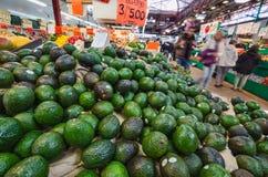Avocados on market tray Stock Photo
