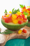 Avocados stuffed with tomato pepper salad Stock Photos