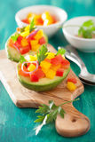 Avocados stuffed with tomato pepper salad Royalty Free Stock Photos