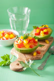 Avocados stuffed with tomato pepper salad Stock Image