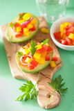 Avocados stuffed with tomato pepper salad Royalty Free Stock Image