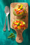 Avocados stuffed with tomato pepper salad Royalty Free Stock Photography