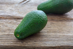 Avocados on a wooden background Royalty Free Stock Image
