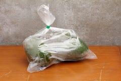 Avocadot i plastpåse Fotografering för Bildbyråer