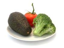 Avocat, tomate et Brocolli Photographie stock libre de droits