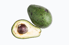Avocatto cut in half on a white background Royalty Free Stock Photos