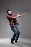 Avoid. Young man wearing  casual clothes avoiding something on grey background Stock Photo