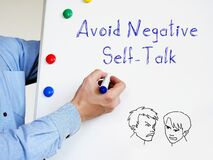 Avoid Negative Self-Talk phrase on the piece of paper
