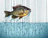 Avoid Risk. Escape danger as a business metaphor with a jumping fish breaking free out of water that is full of sharp fishing bait hooks as a symbol of Royalty Free Stock Images