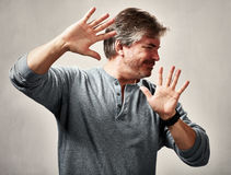 Avoidance. Antisocial man avoidance expression portrait over gray background stock photography