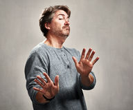 Avoidance. Antisocial man avoidance expression portrait over gray background royalty free stock photography