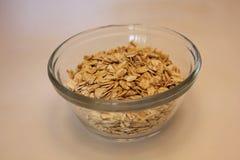 Avoine de farine d'avoine dans un récipient en verre Photo stock