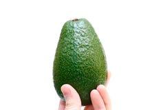Avokado in der Hand getrennt Lizenzfreies Stockbild