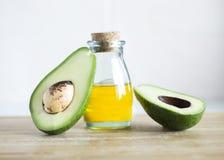 Avokado och olja Arkivfoton