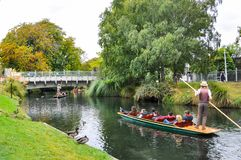 Avon river in Christchurch, New Zealand. Tourists ride the pole boat on the river Royalty Free Stock Images