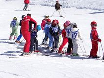 French children form ski school groups stock photo