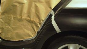 Avrivning av bilen med en malande maskin 4K lager videofilmer