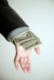 avslöjande för handpengar Arkivbild