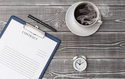 Avtal en kopp kaffe, royaltyfri foto