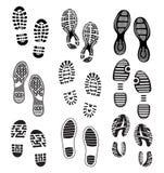 Avtrycken sular skor Arkivfoton