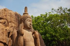 Avukana statue is a standing statue of the Buddha. Sri Lanka. Ho Stock Photography