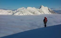 Avventura di inverno sopra la nuvola Immagine Stock