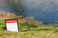 Avvertimento! Immagini Stock