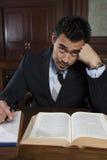 Avvocato teso Sitting With Book e note Immagine Stock Libera da Diritti