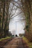 Avvolga la centrale elettrica dietro il vicolo nudo in alt Negentin, Germania Fotografie Stock
