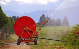 Avvolgitore per tubo industriale di irrigazione fotografia stock