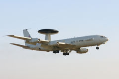 AWACS (No. 2). An AWACS air Scouts of the NATO of the type Boeing E-3A labeled LX N90443 landing on the Geilenkirchen airbase Royalty Free Stock Image