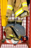 Awaiting the Call. Fireman clothes are prepared for quick use in a locker royalty free stock photos