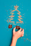 Awaiting for Christmas. Symbols of christmas tree and gifts made Royalty Free Stock Images