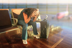 Awaiting for plane with delay. Depressed woman awaiting for plane with delay Stock Images