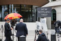 Awaiting a press release at New Scotland Yard. London, UK - 5 June 2017: Journalists and reporters await a press release outside New Scotland Yard in Westminster Stock Photos