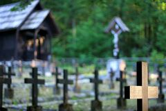Awaiting resurrection day (1). Crosses on soldier graves (chapel and crucifix in the background) on a World War I cemetery in Bohinj, Slovenia Stock Photos