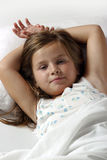 Awake. Young girl in the bed Stock Photos