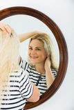 Awake girl looking in mirror on wall Stock Photography