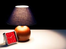 Awake at night - lamp,light and clock in darkness Stock Image