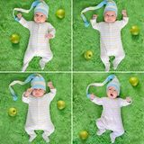 Awakedbaby in grappige hoedenrand met groene appelen Stock Afbeeldingen