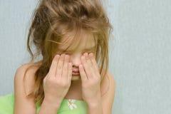 Awakened girl rubbing sleepy eyes Royalty Free Stock Photo