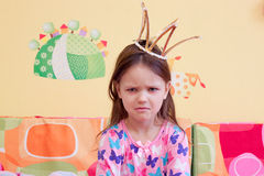 Awakened offended evil little girl early in the morning Royalty Free Stock Image