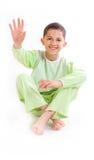 Awakening. Boys in green Pajamas after waking up Stock Photo