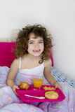 Awakening bed breakfast brunette children girl Royalty Free Stock Images