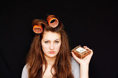 Awakening girl. In curlers dissatisfied early awakening Royalty Free Stock Photos